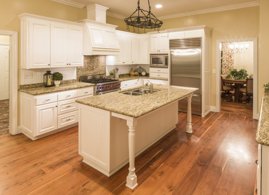 a kitchen with marbled countertops