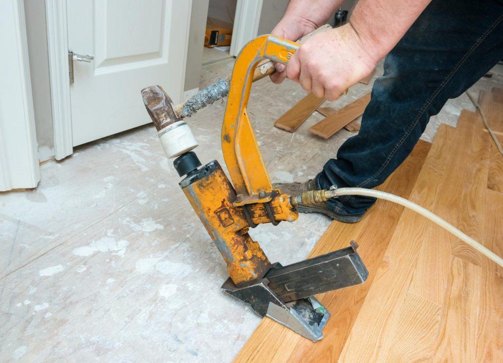 unrecognized person installing wood flooring