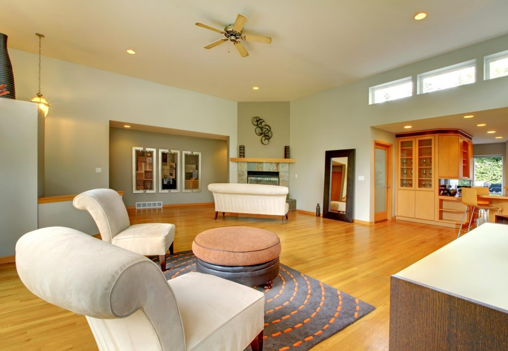a living room with shining flooring