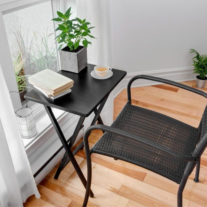 a table and chair facing on the window